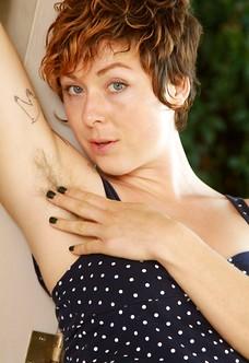 Tattooed hairy redhead babe Luca spreading bush