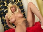 Busty blonde Vanessa fingering her hairy pussy